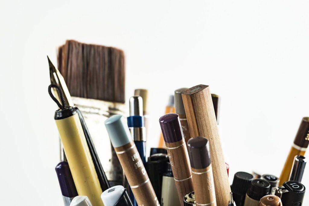 pens, brushes, art materials